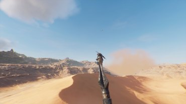 Bayek chilling out on a metal pole in the middle of the desert.